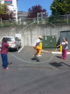 Jumping roping with colleagues during a lunch break